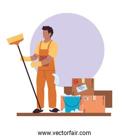 cleaning service man with gloves, cleaning utensils and boxes