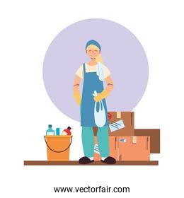 cleaning service woman with gloves, cleaning utensils and boxes
