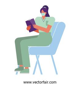professional female surgeon wearing medical mask seated in chair
