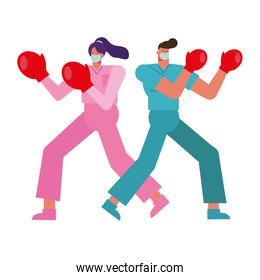professional doctors couple wearing medical masks with boxing gloves