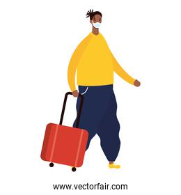 afro young man wearing medical mask with suitcase