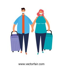 youth couple wearing medical masks with suitcases