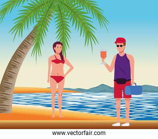 young couple wearing swimsuits on the beach