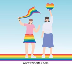 LGBTQ community, young women holding rainbow heart and flag celebration, gay parade sexual discrimination protest