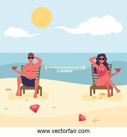 couple seated in beach chairs practicing social distance
