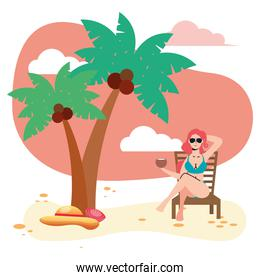 beautiful woman wearing swimsuit seated in beach chair eating coconut