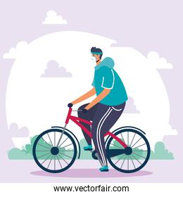 young man wearing medical mask in bicycle