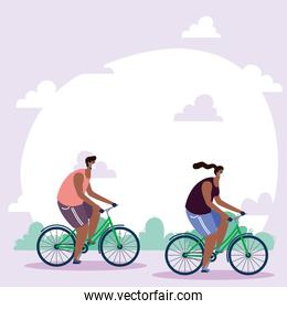 afro young couple wearing medical masks in bicycles