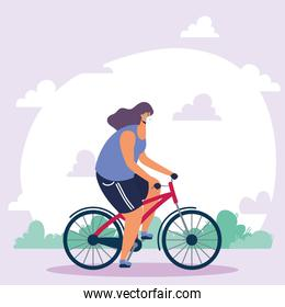 young woman wearing medical mask in bicycle