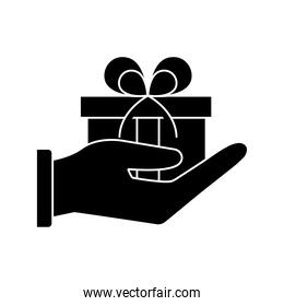 Gift on hand silhouette style icon vector design