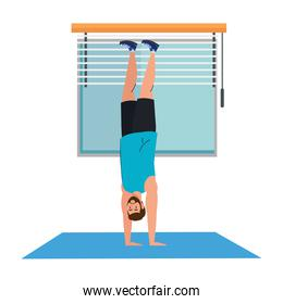 man standing on the hands, in the house, sport recreation exercise