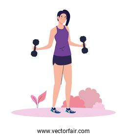 young woman doing exercises with dumbbells outdoor, sport recreation exercise