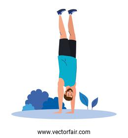 man standing on the hands outdoor, sport recreation exercise