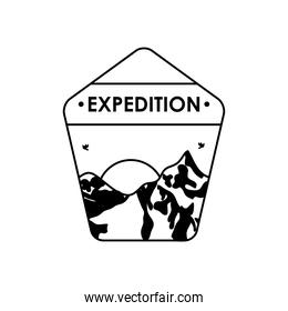 expedition insignia badge with snowy mountains and sun, silhouette style