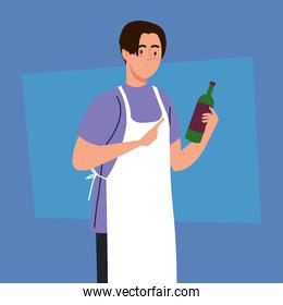 man cooking using apron, with bottle wine