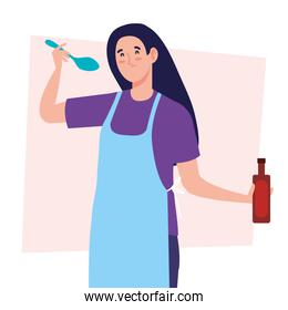 woman cooking using apron, with bottle wine and spoon