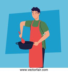 man cooking using apron, with pot and spoon