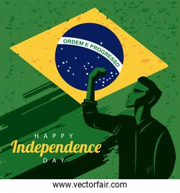 brazil happy independece day celebration with flag and strong man celebrating