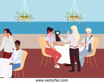 group of people sit at table and order meal