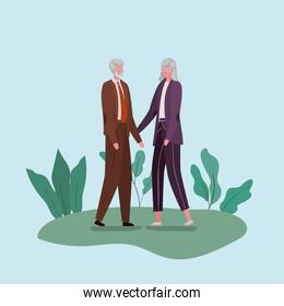 Senior woman and man cartoons with leaves vector design
