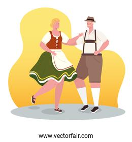 couple german in national dress dancing, woman and man in traditional bavarian costume