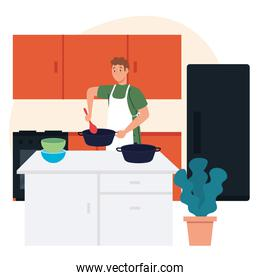 man cooking using apron in scene kitchen with drawers, fridge and supplies