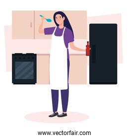 woman cooking in kitchen scene with fridge, drawers and stove