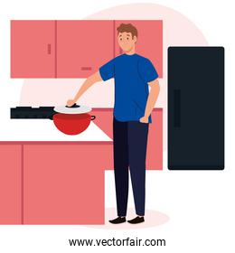 man cooking on scene kitchen with drawers, fridge and supplies