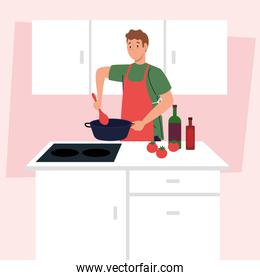 man cooking using apron, on kitchen scene with supplies and vegetables