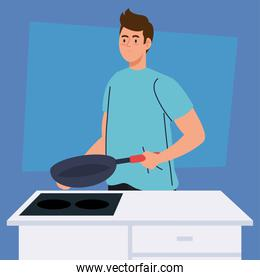 man cooking with frying pan in kitchen scene
