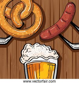 beer glass with pretzel and sausage in wooden background