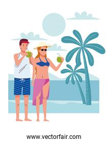 young couple wearing swimsuits drinking coconuts cocktail on the beach scene