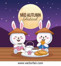 mid autumn celebration card with little rabbits couple eating at night scene