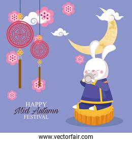 rabbit cartoon in traditional cloth with tea cup on mooncake vector design