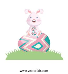 cute easter little rabbit seated in egg painted grass scene