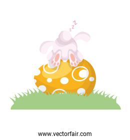 cute easter little rabbit sleeping in egg painted and grass scene