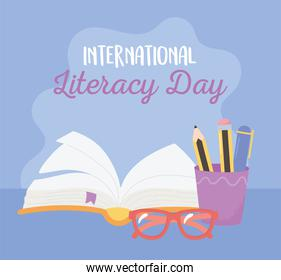 international literacy day, open book pencils in cup and glasses