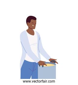 Young cook man with a big pot on white background