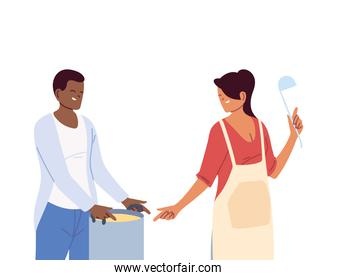 young couple cooking with apron, a pot and kitchen utensils