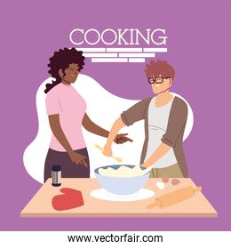 young couple cooking delicious cake in the kitchen