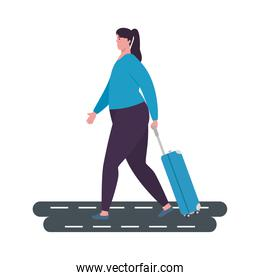 tourist woman walking with luggage over the street