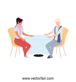 couple in love smiling and talking in restaurant