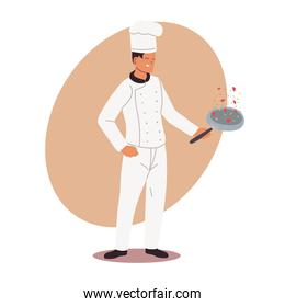 young cook with uniform and frying pan in hand