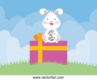 cute easter little rabbit with egg seated in gift