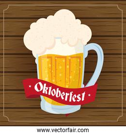 oktoberfest party lettering in ribbon with beer jar in wooden