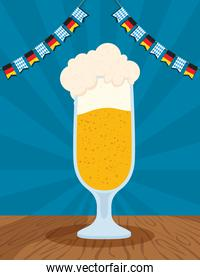 oktoberfest party celebration poster with beer cup and garlands