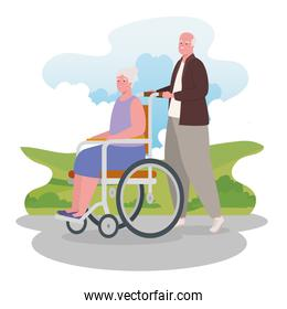 old man walking outdoor with old woman in a wheelchair