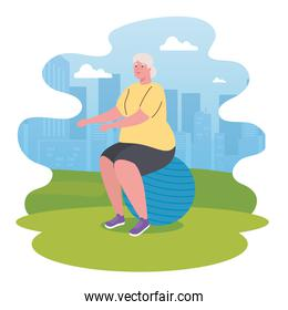 cute old woman practicing exercise in outdoor, sport and recreation concept