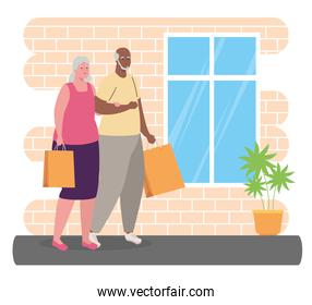 cute old couple with bags shopping