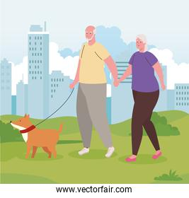 cute old couple walking the dog outdoor